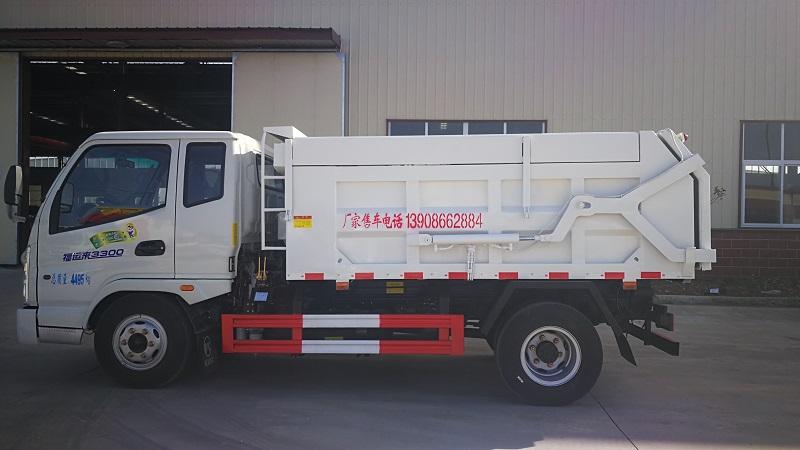 壓縮式垃圾車廠家介紹凱馬藍牌對接式垃圾車和時風藍牌對接式垃圾車