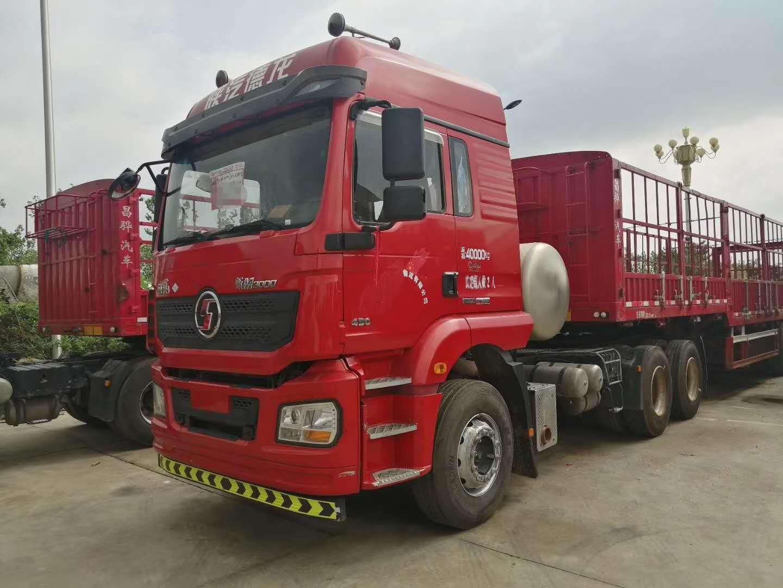 出售二手LNG国五双驱德龙豪沃t7430马力牵引车可按揭