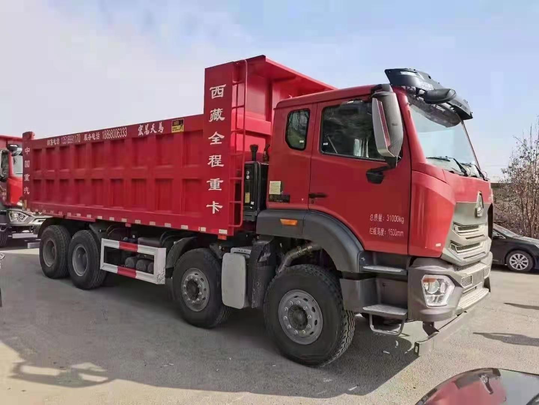 重汽豪瀚6.8米自卸车440马力火红色