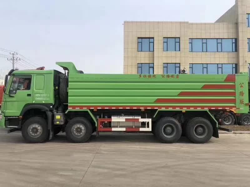 豪沃绿7.6米法规自卸 德国曼440