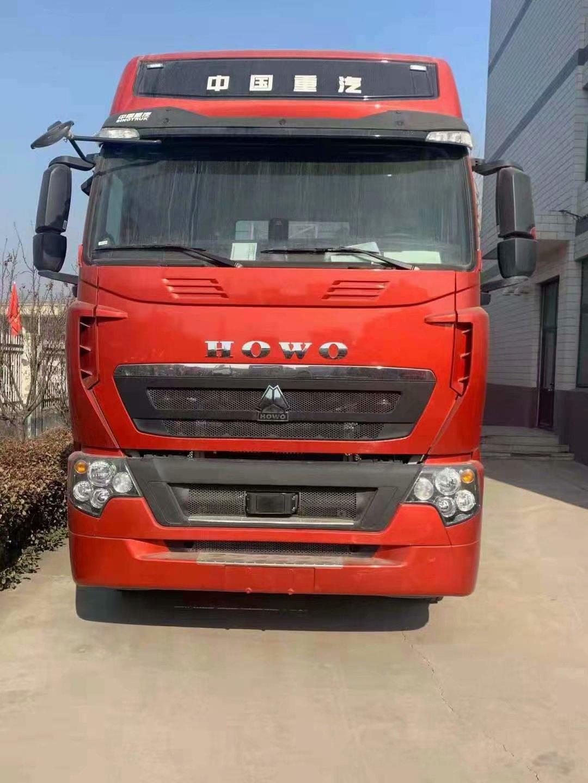 一台水晶红480马力豪沃 带液缓 自动挡 牵引车