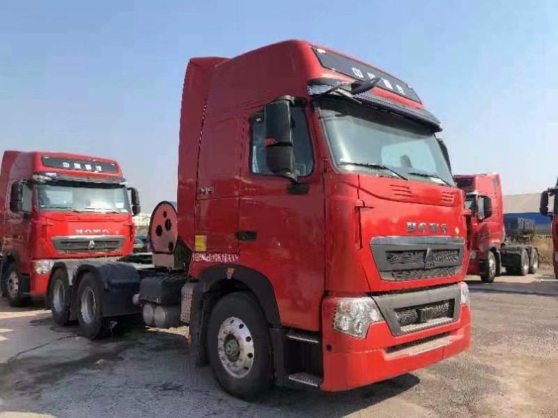 豪沃T7H国六牵引车1000升气瓶,水晶红